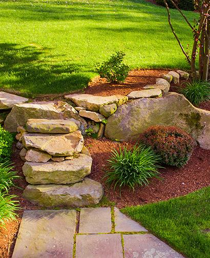 beautiful mulched landscape, rock steps, bushes