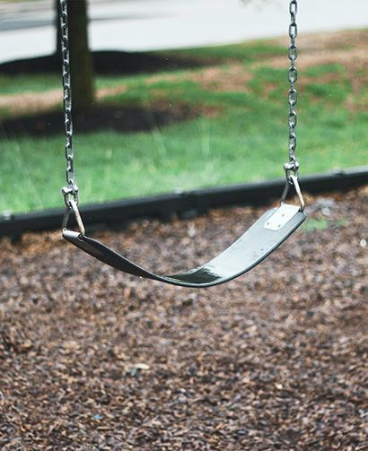 swing in front of brown mulch