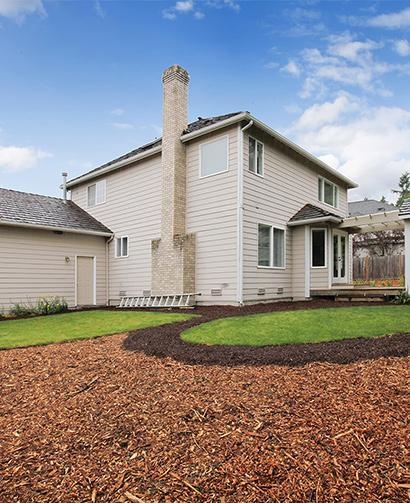 large mulched area in home landscape